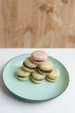 Home-made pistachio macaroons on plate Stock Images