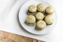 Home-made pistachio macaroons on white plate Royalty Free Stock Photography