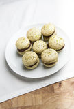 Home-made pistachio macaroons on white plate Stock Photography