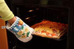 Home-made Pizza In The Oven Royalty Free Stock Images