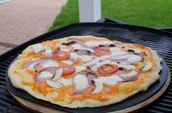 Home made pizza with soda Stock Photos
