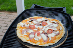 Home made pizza with soda Royalty Free Stock Image