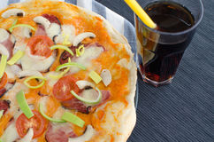 Home made pizza with soda Royalty Free Stock Photography