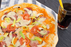 Home made pizza with soda Stock Image
