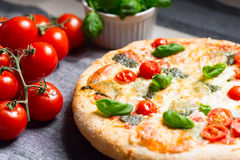 Home made pizza on wooden board Stock Images