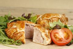 Home made pork pie. Two home made pork pies on a wooden board Stock Photography
