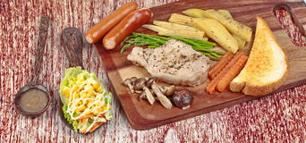 Home made ,Pork steak and mixed vegetables on butcher served served with side dish . Stock Photography