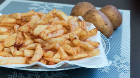 Home made potato chips fries Stock Photos