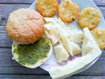 Home made potatoes Croquette. Potato pancake or croquette,, bun sandwich with basil pesto and parmesan cheese .Mediterranean lunch royalty free stock photography