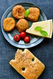 Home made   potatoes Croquette. Potato pancake or croquette , hand made ciabatta bread with olives and spices , parmesan cheese and cherry tomatoes Royalty Free Stock Photography