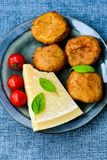 Home made   potatoes Croquette. Potato pancake or croquette , hand made ciabatta bread with olives and spices , parmesan cheese and cherry tomatoes Stock Image