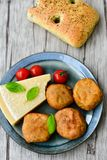 Home made   potatoes Croquette. Potato pancake or croquette , hand made ciabatta bread with olives and spices , parmesan cheese and cherry tomatoes Stock Photography
