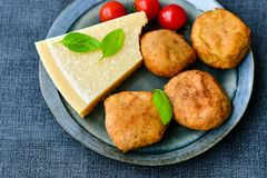 Home made   potatoes Croquette. Potato pancake or croquette , hand made ciabatta bread with olives and spices , parmesan cheese and cherry tomatoes Royalty Free Stock Image