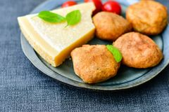 Home made   potatoes Croquette. Potato pancake or croquette , hand made ciabatta bread with olives and spices , parmesan cheese and cherry tomatoes Stock Images