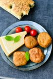 Home made   potatoes Croquette. Potato pancake or croquette , hand made ciabatta bread with olives and spices , parmesan cheese and cherry tomatoes Stock Photo
