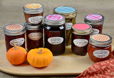 Home made preserves. Of fruit, vegetables and spices in colorful autumn display Stock Photo