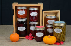 Home made preserves. Of fruit, vegetables and spices in colorful autumn display Stock Image
