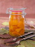 Home-made pumpkin marinated sweet-and-sourly in a glass Stock Image