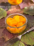Home-made pumpkin marinated sweet-and-sourly in a glass Stock Photos