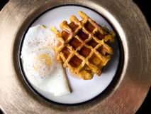 Home made pumpkin waffles and one egg over easy. On Golden Plate Stock Photos