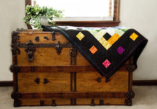 Home-made Quilt on Chest Stock Images
