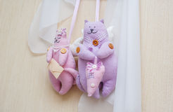 Home-made rag dolls of cat hanging on the wall Stock Photo