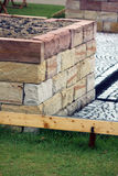 Home made raised garden bed. Raised garden bed building with stone material Stock Photo