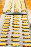 Home made raw Halloween witch finger cookies on a metal plate stock image