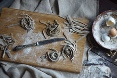Home-made raw noodles. Rustic, Selective Focus, Atmospheric dark tone Royalty Free Stock Image