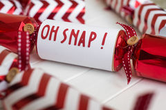 Home made red christmas cracker with fun phrase Royalty Free Stock Images