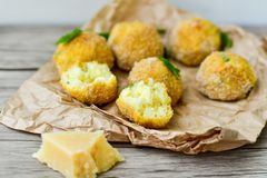 Home made    rice italian style  Croquette.Arancini. Rice balls or croquette  with parmesan cheese Stock Photography