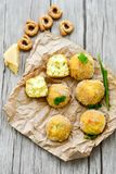 Home made    rice italian style  Croquette.Arancini. Rice balls or croquette  with parmesan cheese and italian bread stick taralli Stock Image