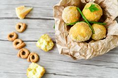 Home made    rice italian style  Croquette.Arancini. Rice balls or croquette  with parmesan cheese and italian bread stick taralli Royalty Free Stock Images