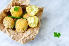 Home made    rice italian style  Croquette.Arancini. Rice balls or croquette  with parmesan cheese and italian bread stick taralli Royalty Free Stock Image