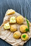 Home made rice italian style Croquette. Arancini. Rice balls or croquette , parmesan cheese, taralli bread stick stock photo
