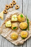 Home made rice italian style Croquette. Arancini. Rice balls or croquette , parmesan cheese, taralli bread stick royalty free stock photos