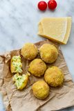 Home made rice italian style Croquette. Arancini. Rice balls or croquette , parmesan cheese, taralli bread stick royalty free stock image