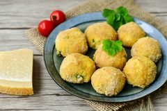 Home made rice italian style Croquette. Arancini. Rice balls or croquette , parmesan cheese, taralli bread stick stock images