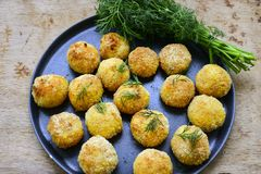 Home made rice italian style Croquette.Arancini with runa fish. Healty  baked Rice balls or croquette with parmesan cheese, tuna fish royalty free stock photos