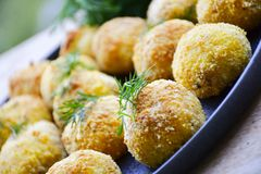 Home made rice italian style Croquette.Arancini with runa fish. Healty  baked Rice balls or croquette with parmesan cheese, tuna fish royalty free stock image