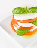 Fresh mozzarella and tomato salad Stock Images