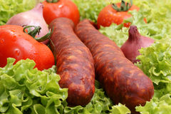 home made salami and organic lettuce Royalty Free Stock Photography