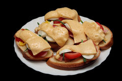 Home-made sandwiches with cheese, sausage, egg and. Home-made sandwiches with cheese, sausage and tomato on a black background Royalty Free Stock Photos