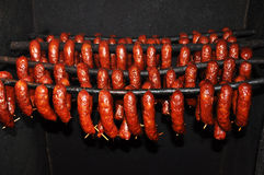 Home made sausage. Some home made sausage put on a stick to dry Stock Photos