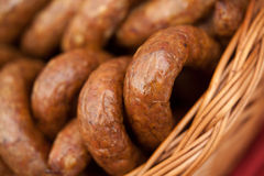 Home-made sausage. Prepared by polish butcher. Presented in wooden basket Stock Photo