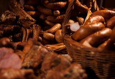 Home-made sausage. Prepared by polish butcher. Presented in wooden basket Stock Image