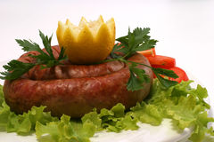 Home made sausage with tomatoes and lemon Royalty Free Stock Images