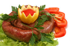 Home made sausage with tomatoes and lemon Royalty Free Stock Photo