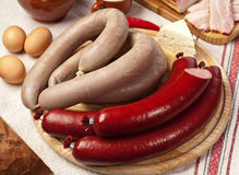 Home-made sausages on the cutting board. Royalty Free Stock Photo