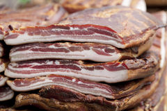 Home made smoked bacon on the table royalty free stock photo